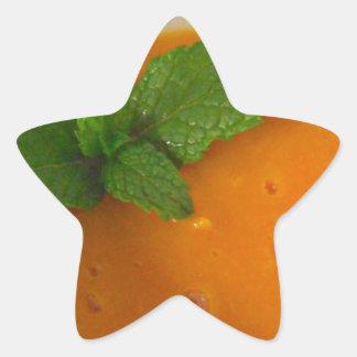 orange banana mango smoothie with green peppermint star sticker