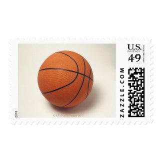 Orange basketball, close-up postage stamp