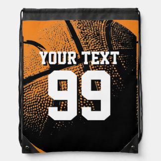 Orange basketball jersey number drawstring bags