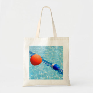 Orange beach ball in a swimming pool tote bag