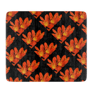 Orange black clivia photomontage pattern cutting board