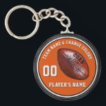 "Orange, Black, White Personalized Football Gifts Keychain<br><div class=""desc"">Orange and Black and White Personalized Football Gifts. You, or Designers Rod and Linda: 239-949-9090 can CHANGE the Colors. Type into the 4 Text Boxes for Player&#39;s Name, Number, Year and Team Name or Delete. Cheap football gifts for kids football favors and other football party ideas. CALL Designers Rod and...</div>"