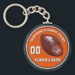 """Orange, Black, White Personalized Football Gifts Keychain<br><div class=""""desc"""">Orange and Black and White Personalized Football Gifts. You, or Designers Rod and Linda: 239-949-9090 can CHANGE the Colors. Type into the 4 Text Boxes for Player&#39;s Name, Number, Year and Team Name or Delete. Cheap football gifts for kids football favors and other football party ideas. CALL Designers Rod and...</div>"""