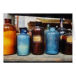 Orange, Brown and Blue Bottles of Chemicals Cards