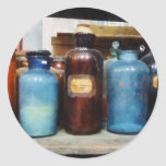 Orange, Brown and Blue Bottles of Chemicals Sticker