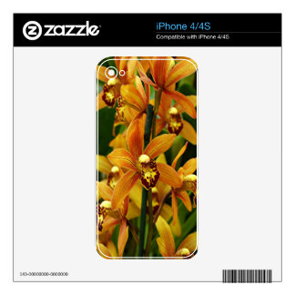 Orange brown orchid flowers in bloom skins for the iPhone 4S