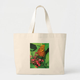 Orange Butterfly on Red Kalanchoe Canvas Bags