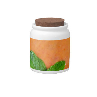 orange carrot smoothie with green peppermint leave candy dishes