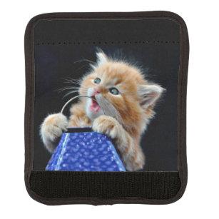 Orange Cat Cub Playing and Biting Blue Luggage Handle Wrap