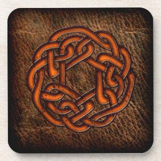 Orange celtic knot on leather beverage coaster