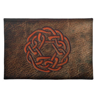 Orange celtic knot on leather cloth placemat