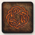 Orange celtic knot on leather coasters