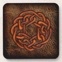 Orange celtic knot on leather drink coaster
