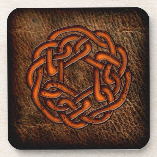 Orange celtic knot on leather drink coaster