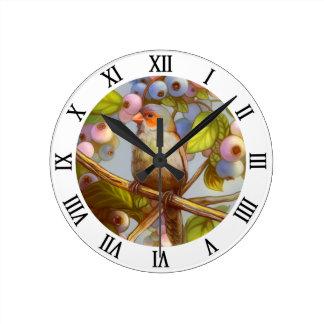 Orange cheeked waxbill finch with blueberries round clock