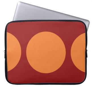 Orange Circles on Red Computer Sleeve