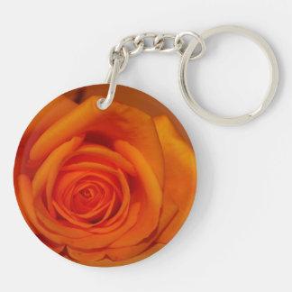 Orange colorized rose against orange background round acrylic keychain