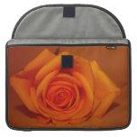 Orange colorized rose against orange background MacBook pro sleeves