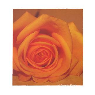 Orange colorized rose against orange background memo notepad