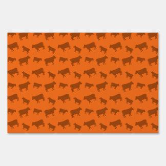 Orange cow pattern sign