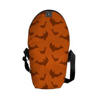 Orange dolphin pattern courier bag