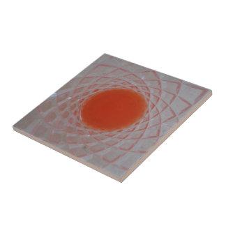 Orange drink inside a crystal glass ceramic tile