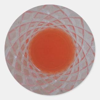 Orange drink inside a crystal glass classic round sticker