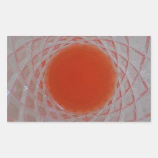 Orange drink inside a crystal glass rectangular sticker