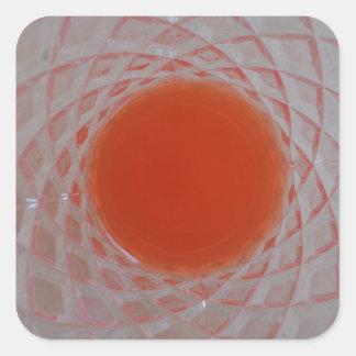 Orange drink inside a crystal glass square sticker