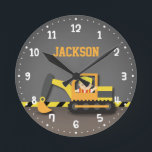"Orange Excavator Construction Boys Room Decor Round Clock<br><div class=""desc"">Decorate a boys room or baby boy nursery with this colourful, striking and cute design! Design has a little builder boy in a safety hat and bright orange vest driving an orange, yellow and grey excavator at a construction site! There is a yellow and black slanted stripes for the background...</div>"