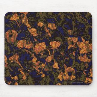 Orange flower against leaf camouflage pattern mouse pad
