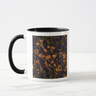 Orange flower against leaf camouflage pattern mug