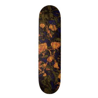 Orange flower against leaf camouflage pattern skateboard deck