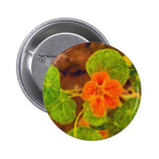 Orange flower and green leaves 2 inch round button