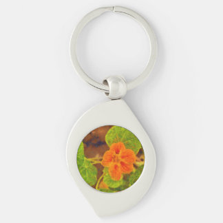 Orange flower and green leaves Silver-Colored swirl metal keychain