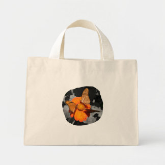 Orange flower and orange butterflies photograph mini tote bag