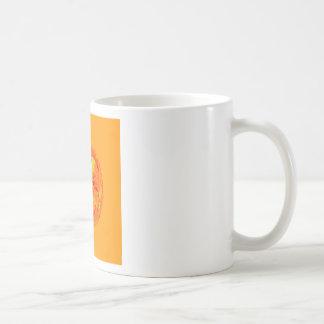 Orange flower in globe coffee mug