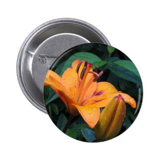 Orange flower with raindrops pinback button