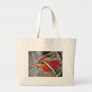 orange green, yellow and fall leaf and dried grass tote bag