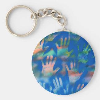 Orange hands on a blue background basic round button keychain