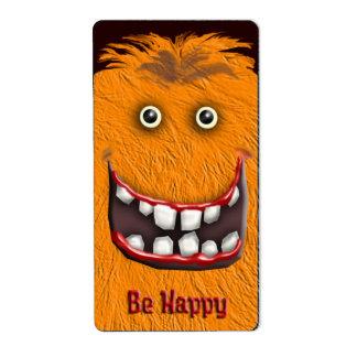 orange happy monster label