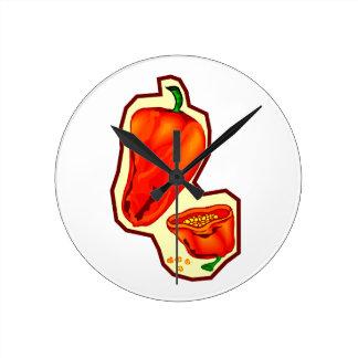 Orange hot peppers one cut in half graphic round clock