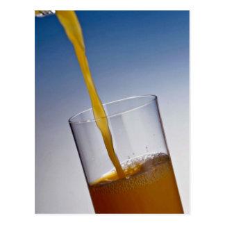 Orange juice poured into glass postcard