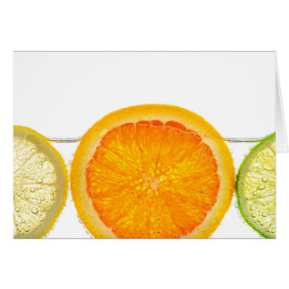 Orange lemon and lime slices in water card