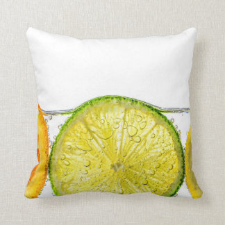 Orange lemon and lime slices in water pillow