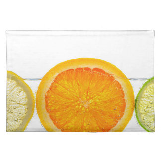 Orange lemon and lime slices in water cloth place mat