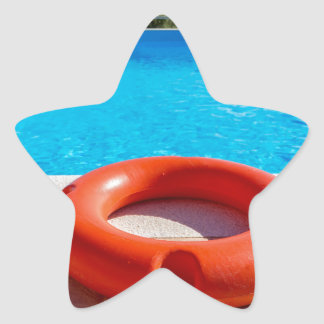 Orange life buoy at blue swimming pool star sticker