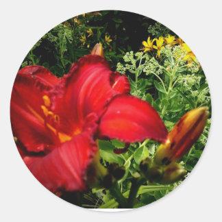 Orange lillies happy in the garden classic round sticker