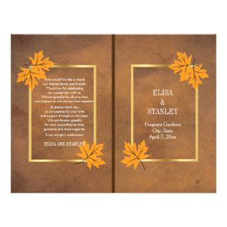 Orange maple leaves on brown wedding program