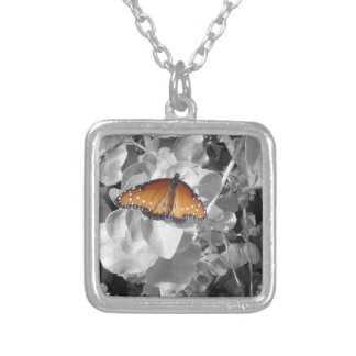 Orange Monarch Butterfly Against Black and White Silver Plated Necklace